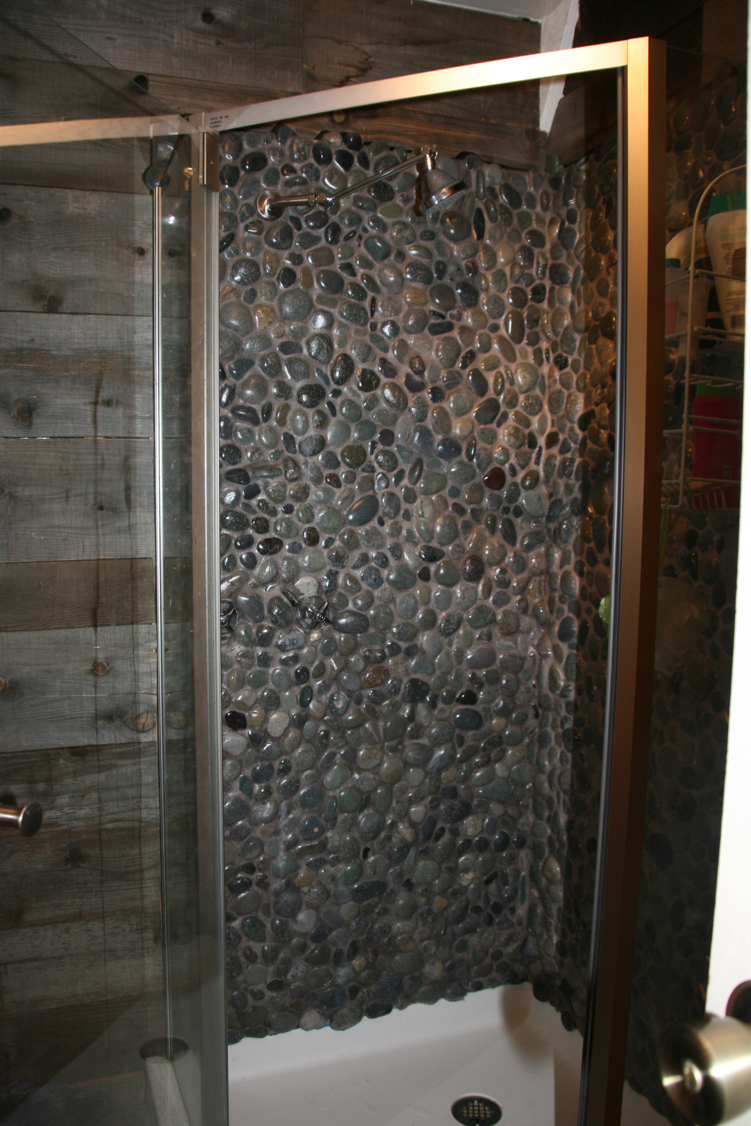 The Shower Walls Were Created Using The Same Rocks As The Countertop. They  Were Placed With Gray Thinset, Then Gray Grout Piped In Between Each Rock.